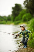 Photo of little boy fishing — Stock Photo