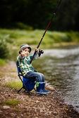 Photo of little boy fishing — Stok fotoğraf