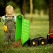 Little constructor with shovel — Stock Photo #17696269