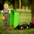 Little constructor with shovel - Stock Photo