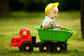 Young constructor sitting in the car — Stock Photo