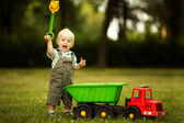 Little constructor with shovel — Stock Photo