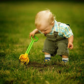 Little helper with a shovel — Stock Photo