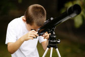 Little boy with telescope — Stock Photo