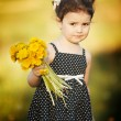 Stock Photo: Cute little girl with dandelions