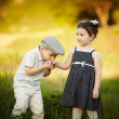 Stock Photo: Little boy kissed a girl