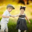 Boy holding girl's hand — Stock Photo