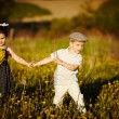 Cute boy and girl on summer field — Stock Photo #19538923