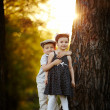 Stock Photo: Boy and girl on sunset