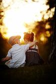 Boy and girl on sunset — Zdjęcie stockowe