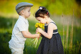 Cute boy and girl on summer field — Photo