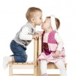 Little cute boy kissing a girl — Stock Photo