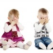 Little boy and girl covers his face — Stock Photo