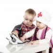 Boy and girl playing with tonometer — Stock Photo