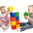Boy and girl playing with cubes — Stock Photo