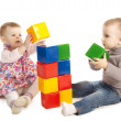 Boy and girl playing with cubes — Stock Photo #21434531