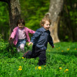 Little boy and girl running away — Stock Photo #21443287
