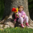 Little sweet girl with flowers — Stock Photo