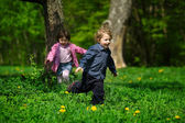 Little boy and girl running away — Stock Photo