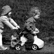 Boy and girl in park with toy car — Stock Photo #22083417