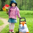 Beautiful little girl with car in park — Stock Photo