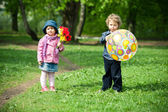Boy and girl in park — Stok fotoğraf