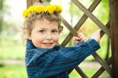 Little boy with wreath — Stock Photo
