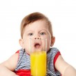 Little cute baby with glass of juice isolated — Stock Photo #23130136
