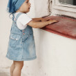Young girl looks to the window -  