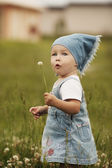 Cute little girl with flower — Stock Photo
