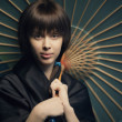Beautiful girl with japan umbrella — Stock Photo #25587293