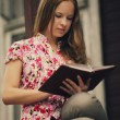Stock Photo: Beautiful girl reading book