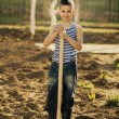 Little boy working with shovel in garden — Stock Photo