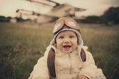 Little baby dreaming of being pilot — Stock Photo