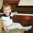 Little boy plays piano — Stock Photo