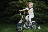 Little boy with bicycle — Stock Photo
