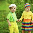 Boy with a girl in bright colored clothing — Stock Photo #30259483