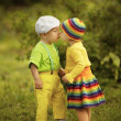 Boy with a girl in bright colored clothing — Stock Photo #30259529