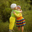 Boy with a girl in bright colored clothing — Stock Photo #30259567