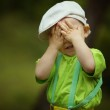 Little boy plays hide and seek — Stock Photo #30259853