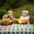 Boy and girl on picnic in park — Foto Stock