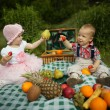 Boy and girl on picnic in park — Stok fotoğraf