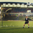 Little boy plays football — Stock Photo