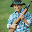 Little boy with airgun — Stock Photo