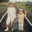 Boys with suitcase on railways — Stock Photo