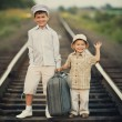 Boys with suitcase on railways — 图库照片