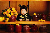 Little funny baby with bee costume — Stock Photo
