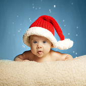 Little cute girl with santa hat — Stock Photo