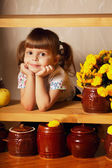 Little cute girl with a pot of honey — Stock Photo