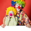 Big and little funny clowns — Stock Photo #32529529